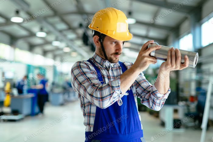 Portrait of an metal engineer working at factory