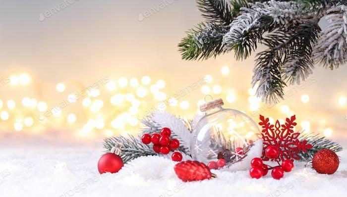 Christmas ornaments on the snow