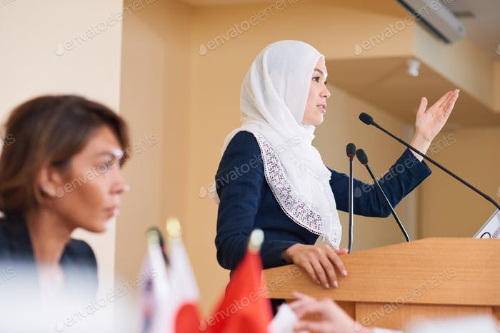Young contemporary confident female politician in hijab