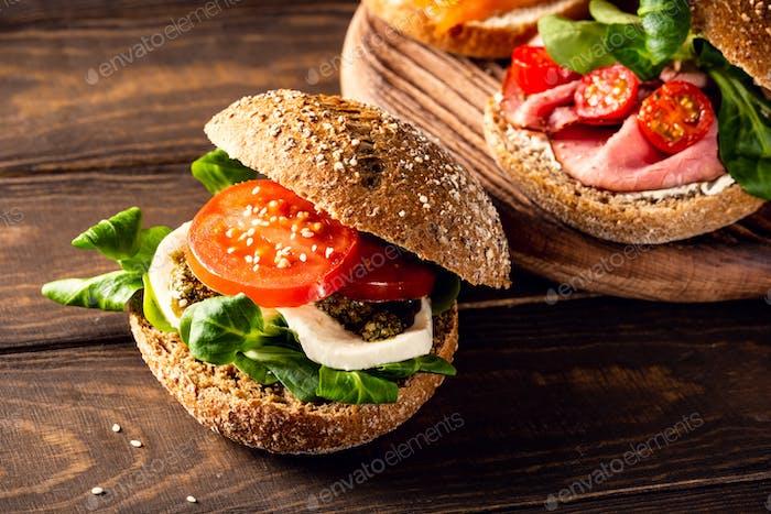 Italian Caprese sandwiches with fresh tomatoes, mozzarella cheese