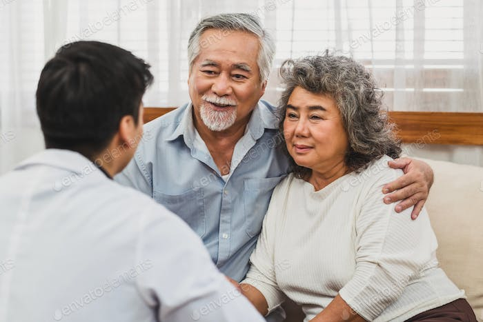 Rear view of Doctor Give advice to couple Asian grandparent patient in house, service Life insurance