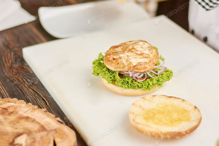 Cooking burger with chicken meat