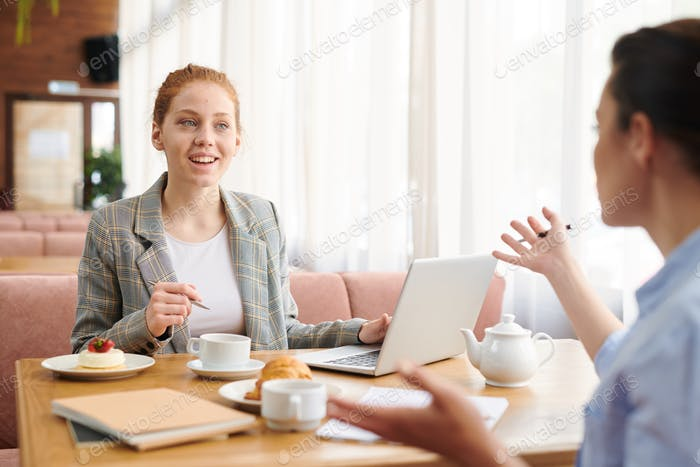 Meeting of business ladies in cafe