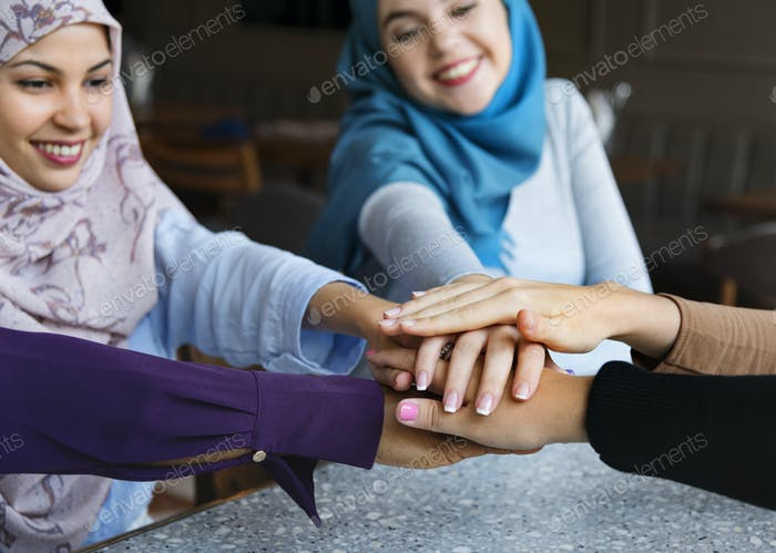Islamic friends hands stack for teamwork