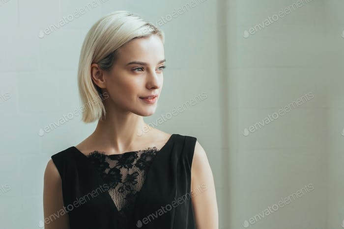 Blonde woman lady portrait casual in black dress. Happy female blond beauty girl