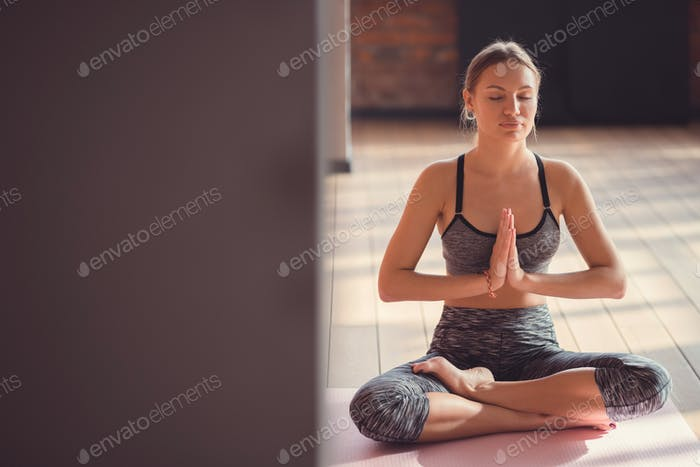 Yoga instructor in the loft