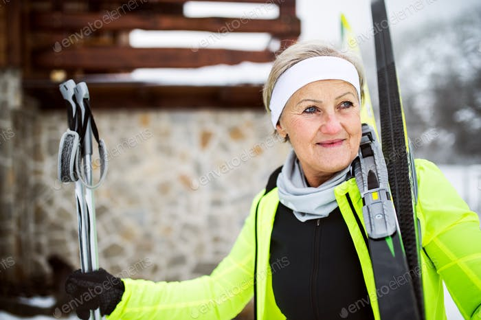 Thumbnail for Senior woman getting ready for cross-country skiing.