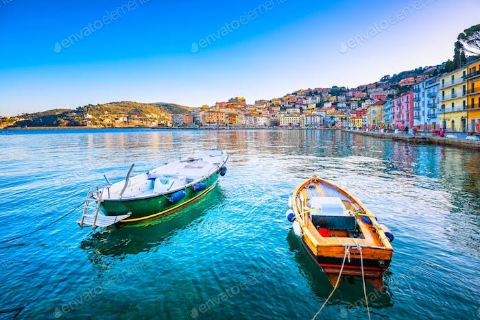 Wooden small boats in Porto Santo Stefano seafront. Argentario,