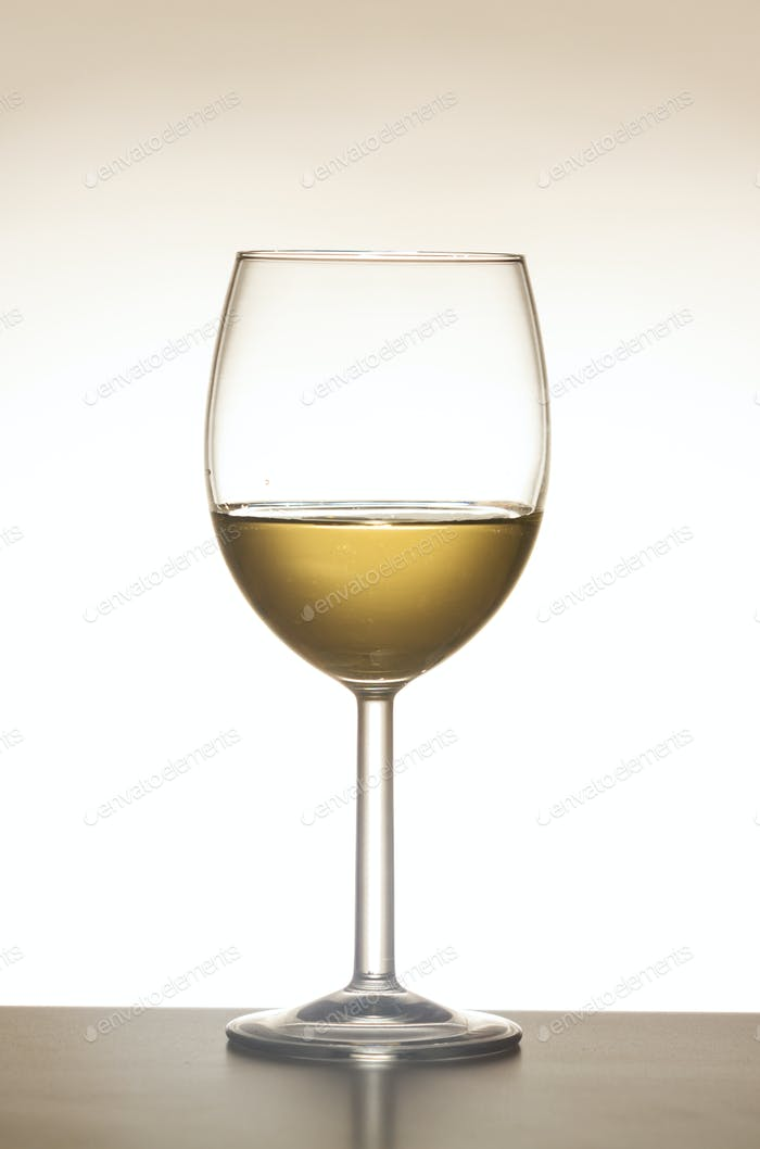 Wine glass white wine isolated against white background.