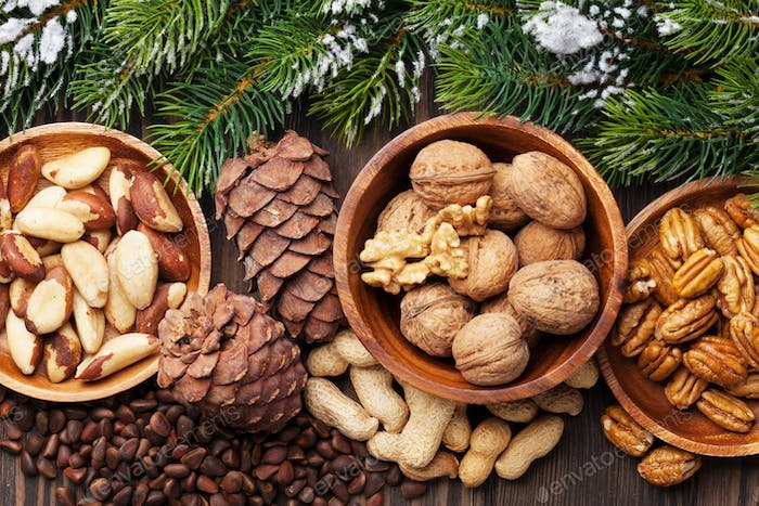 Various nuts on wooden table