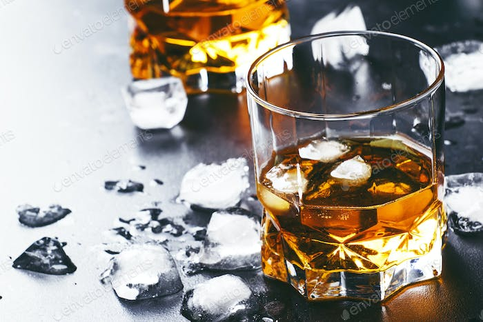 Cold whiskey with ice cubes