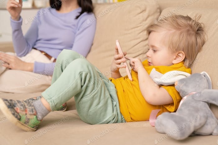 Little boy playing smartphone game