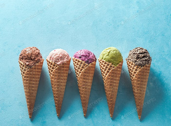 ice cream scoops in cones with copy space on blue