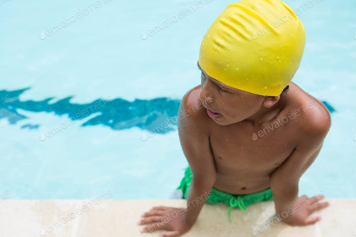 Boy standing in swimming pool