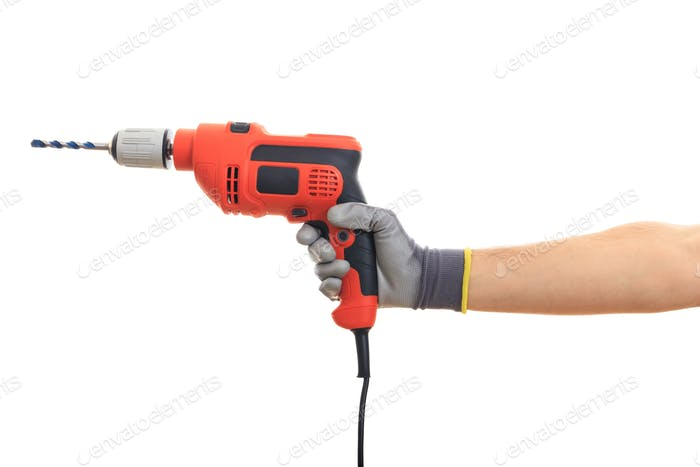 Gloved hand holding an electric drill on white background