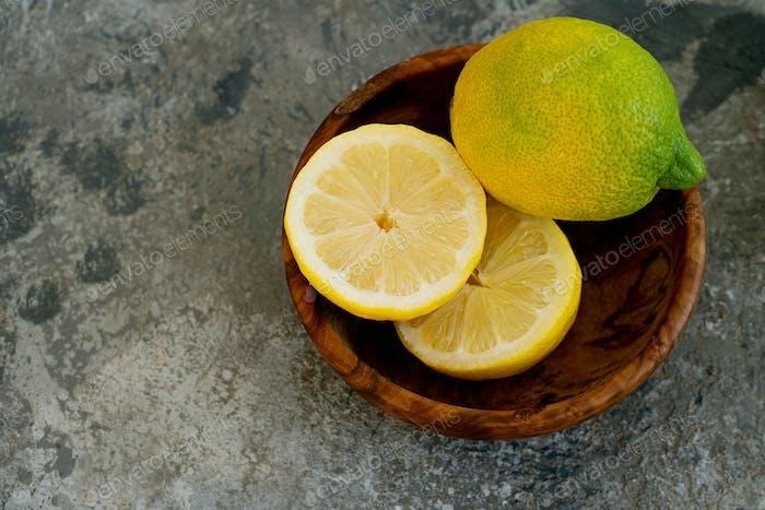 Lemons  in wooden bowl