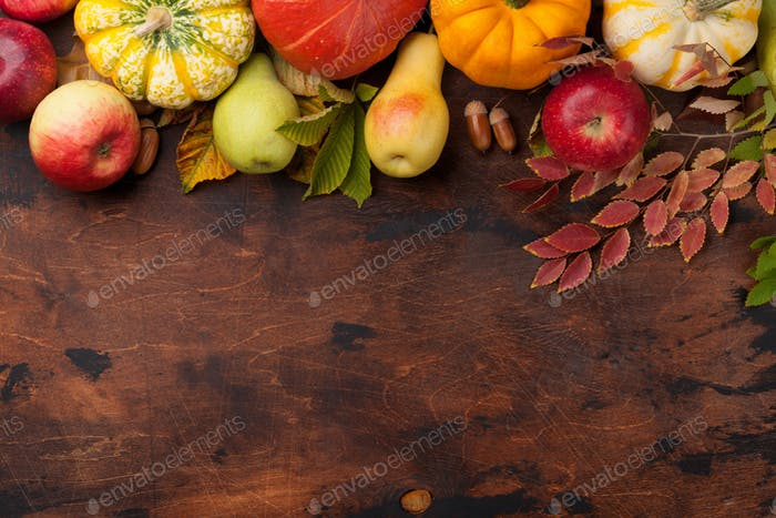 Autumn with pumpkins and colorful leaves