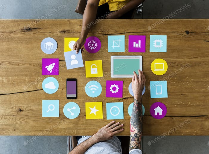 Group of computer icon on the wooden table