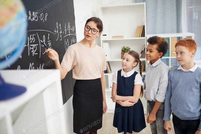 Teacher teaching the maths
