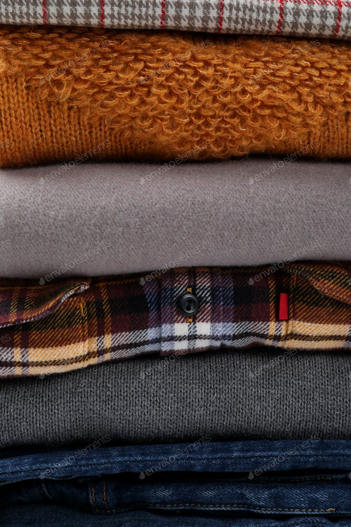 Stack of winter clothes all over background