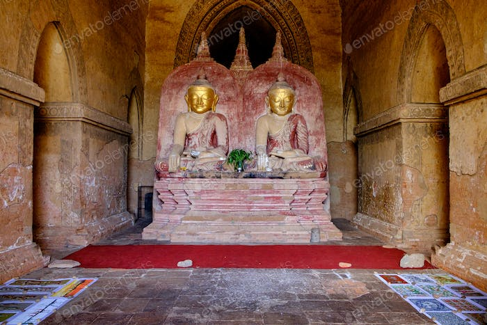 Two golden Buddha statues in the ancient temple at Bagan
