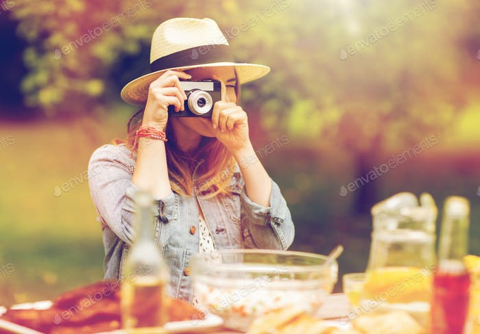 close up of woman with camera shooting outdoors
