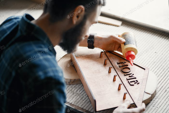 Woodworker applying glue to coards