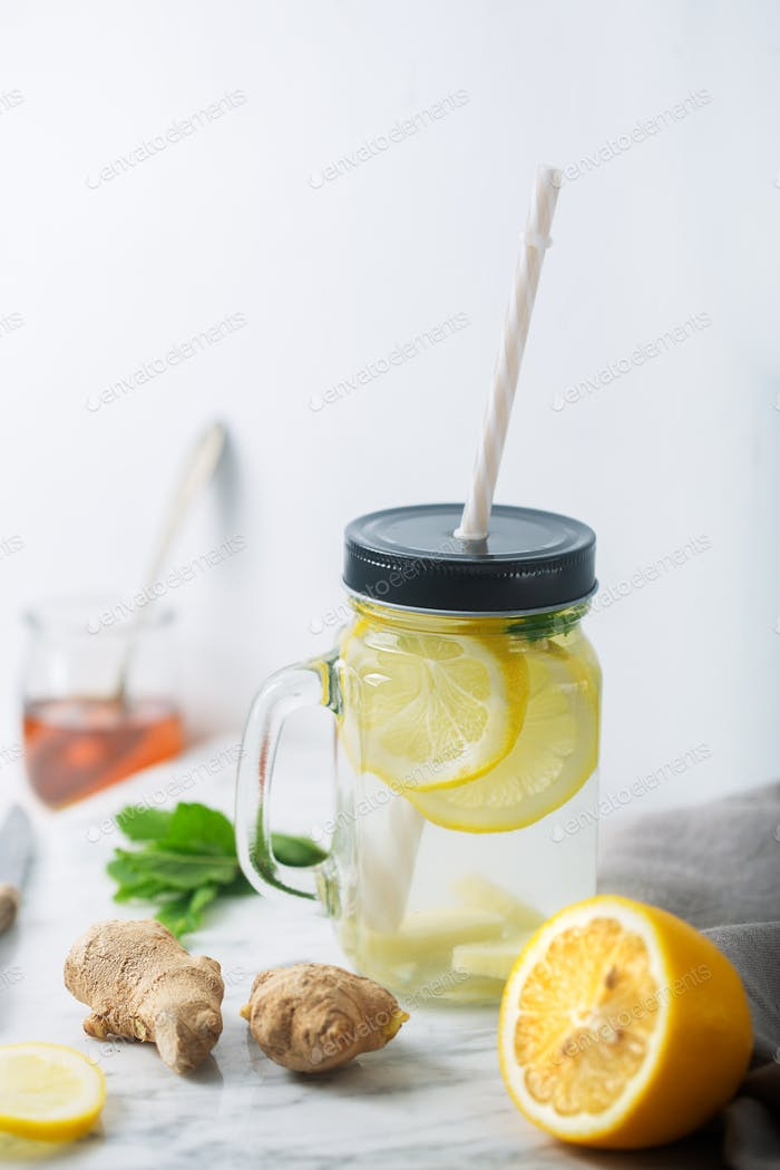 Ginger Water in Glass jar With Lemon and Honey, Vertical Orientation, White Background