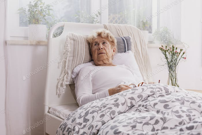 Old woman lying in bed
