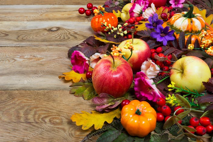Thanksgiving decoration with yellow, pink and purple flowers, co