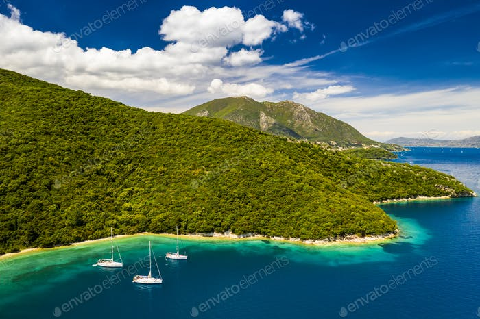 Yachts in the bay near the green island. Summer vacation, Greece, Kefalonia