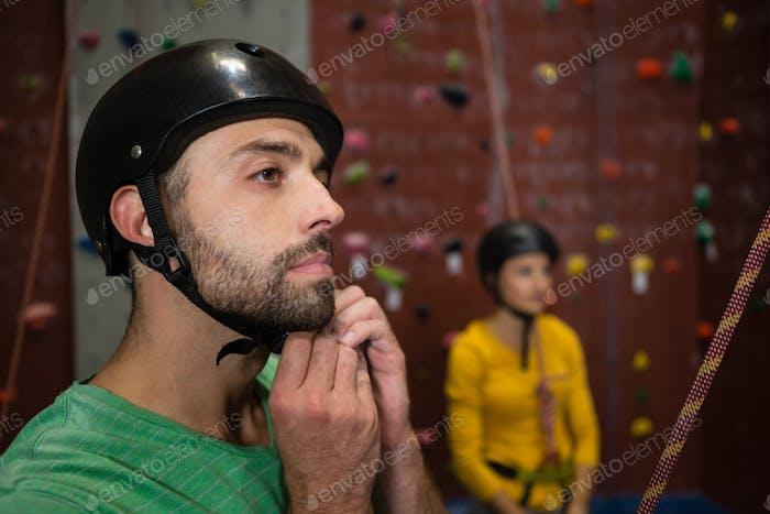 Male athlete wearing sports helmet in health club