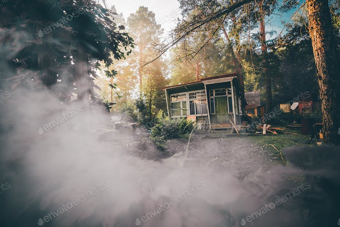 A cabin in woods in the smoke