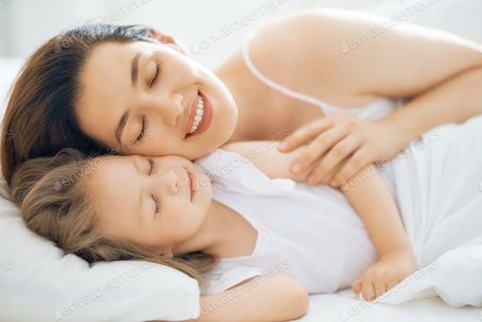 girl and her mother enjoying sunny morning