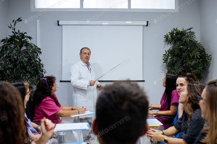concentrated group of young team workers of dental clinic in a meeting