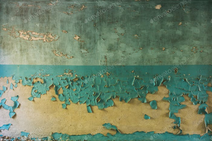 Wall With Cracked And Peeling Surface Of Blue And Brown Or Yello