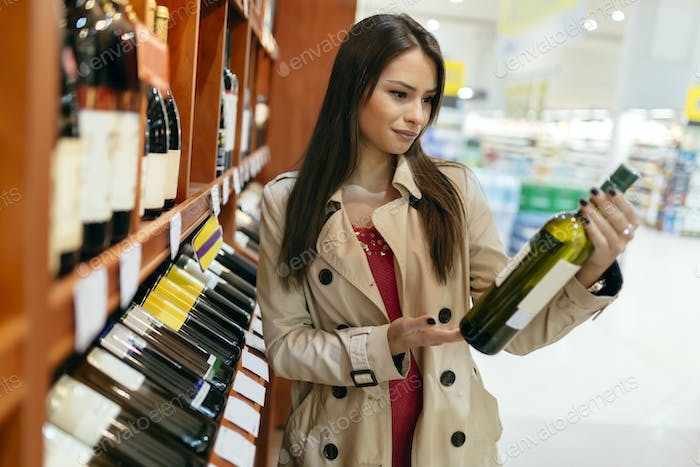 Beautiful woman buying wines