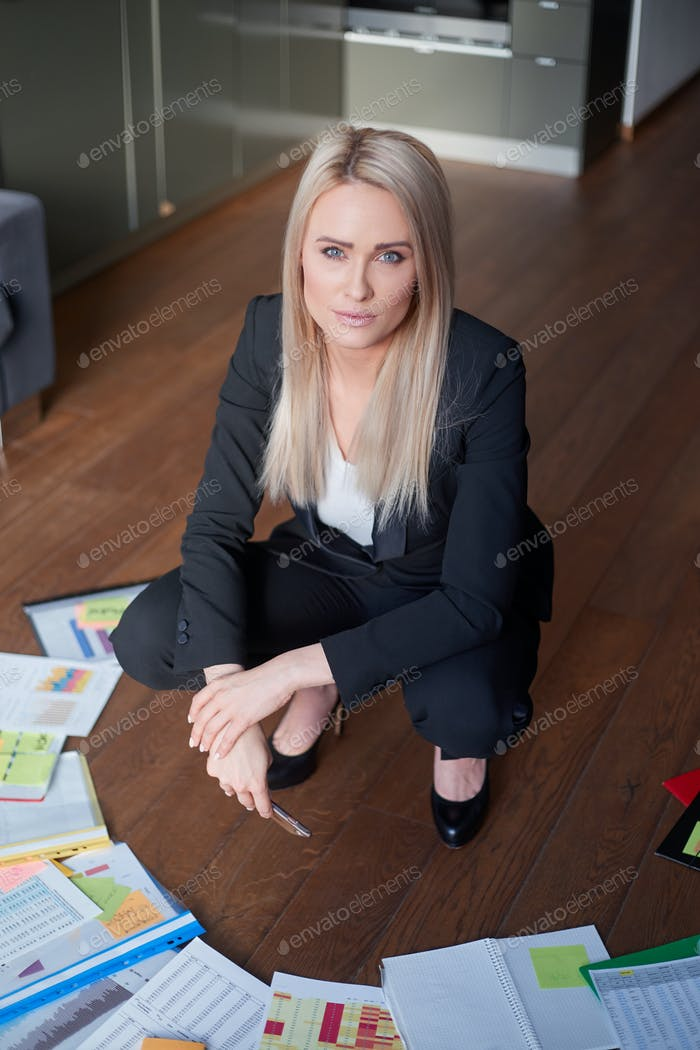 Beautiful blond business woman in her home office