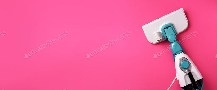 Steam cleaner mop on pink background. Top view, flat lay. Banner with copy space. Cleaning service