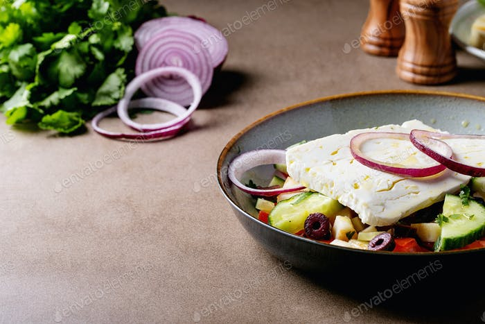 Feta cheese salad in ceramic bowl