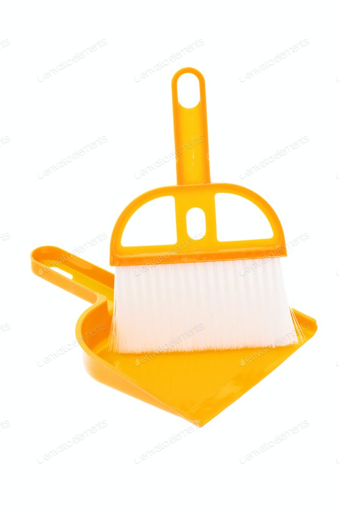 Plastic dust pan and brush in yellow