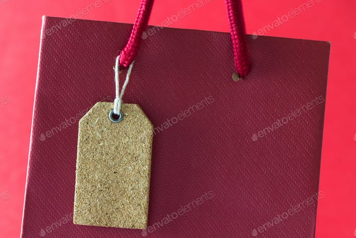 Blank tag on red paper bag
