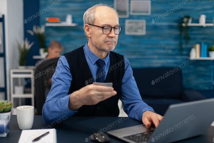 Senior man using credit card