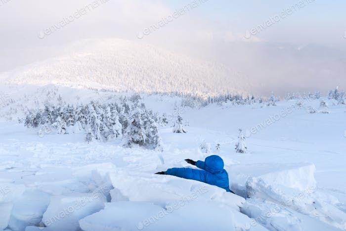 A man covered with a snow avalanche