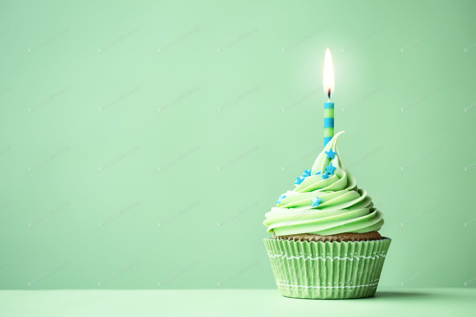 Green birthday cupcake photo by RuthBlack on Envato Elements