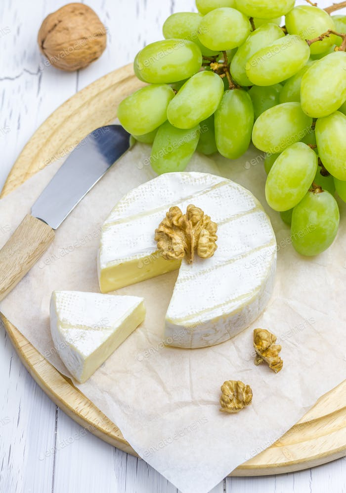 Soft brie cheese with sweet grapes and nuts