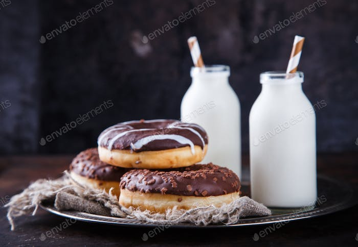 Chocolate donuts with milk