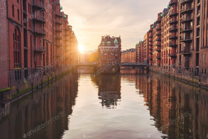 Historical famous warehouse district at sunset golden ray light located in Hamburg city old port