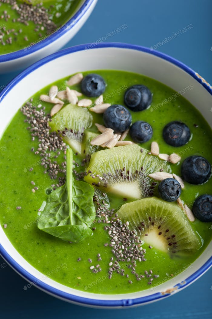 green smoothie bowl spinach kiwi blueberry banana with chia seed