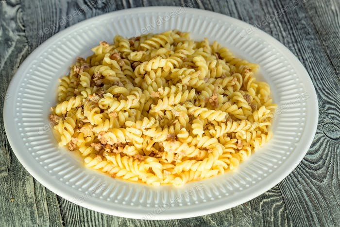 Traditional Italian pasta or fussili with mince